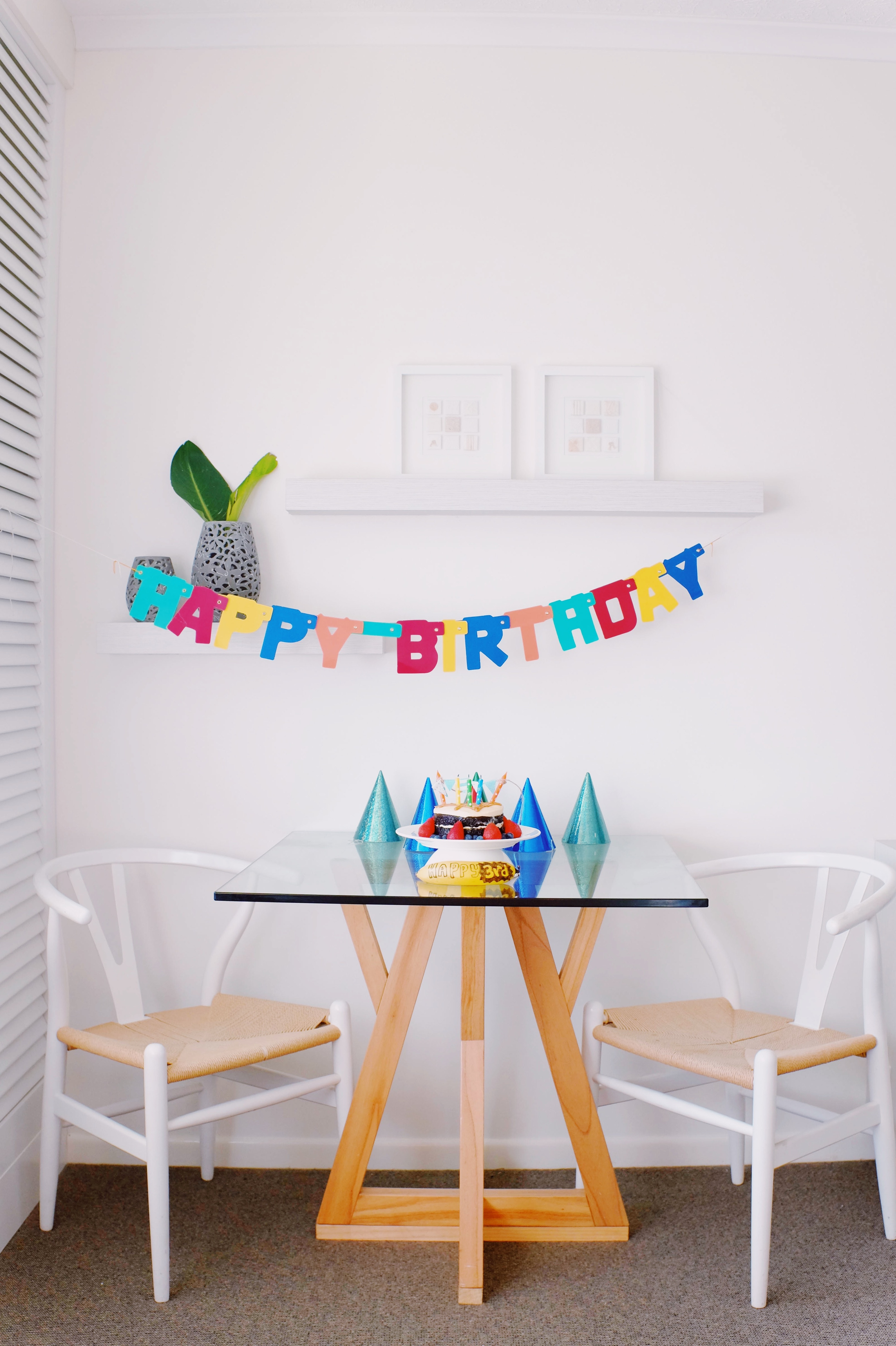 happy birthday banner on the wall