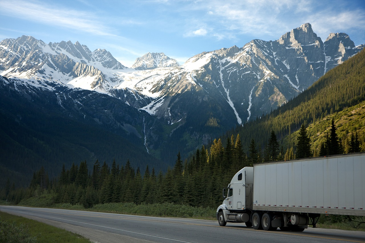 Semi truck with mountains in the background